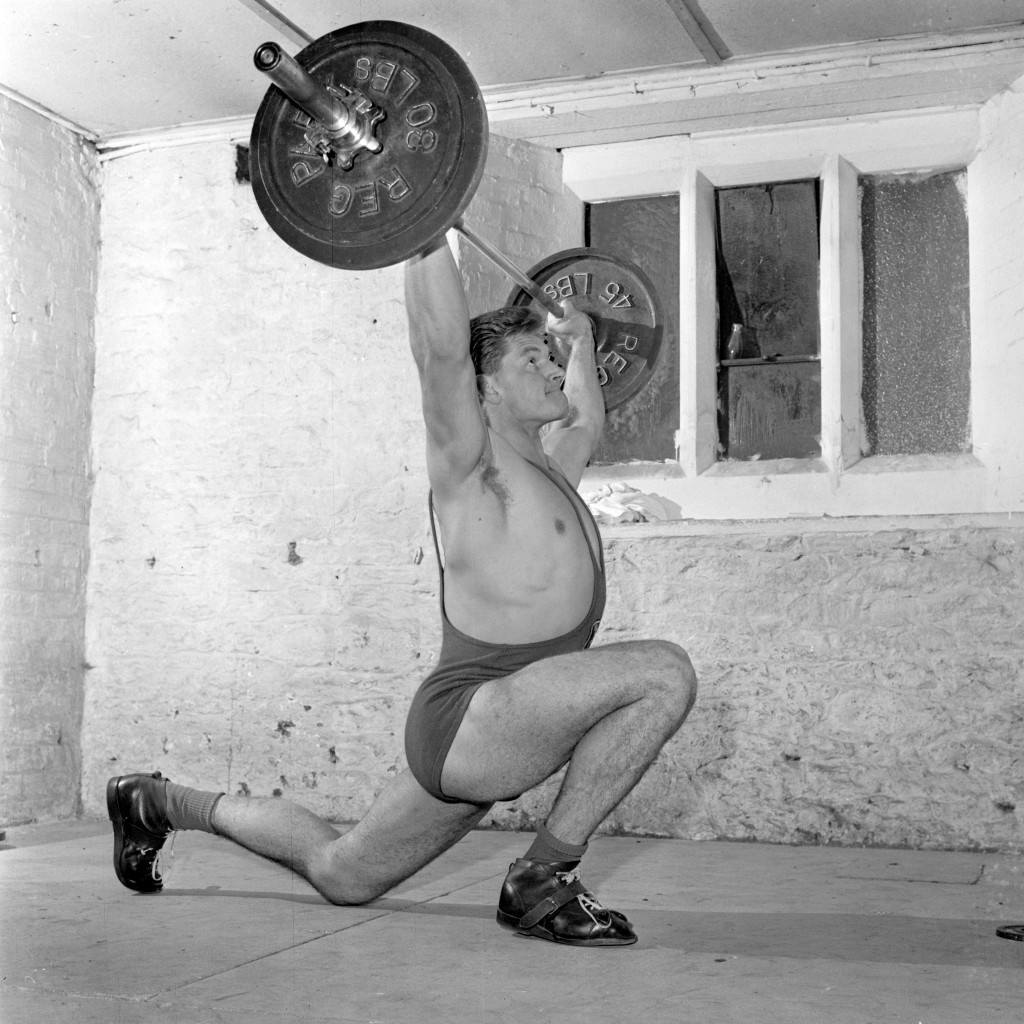 Weight-lifting champion David Prowse, 27, of Southmead, Bristol, trains in his home town for the Empire Games to be held in Perth, Australia.