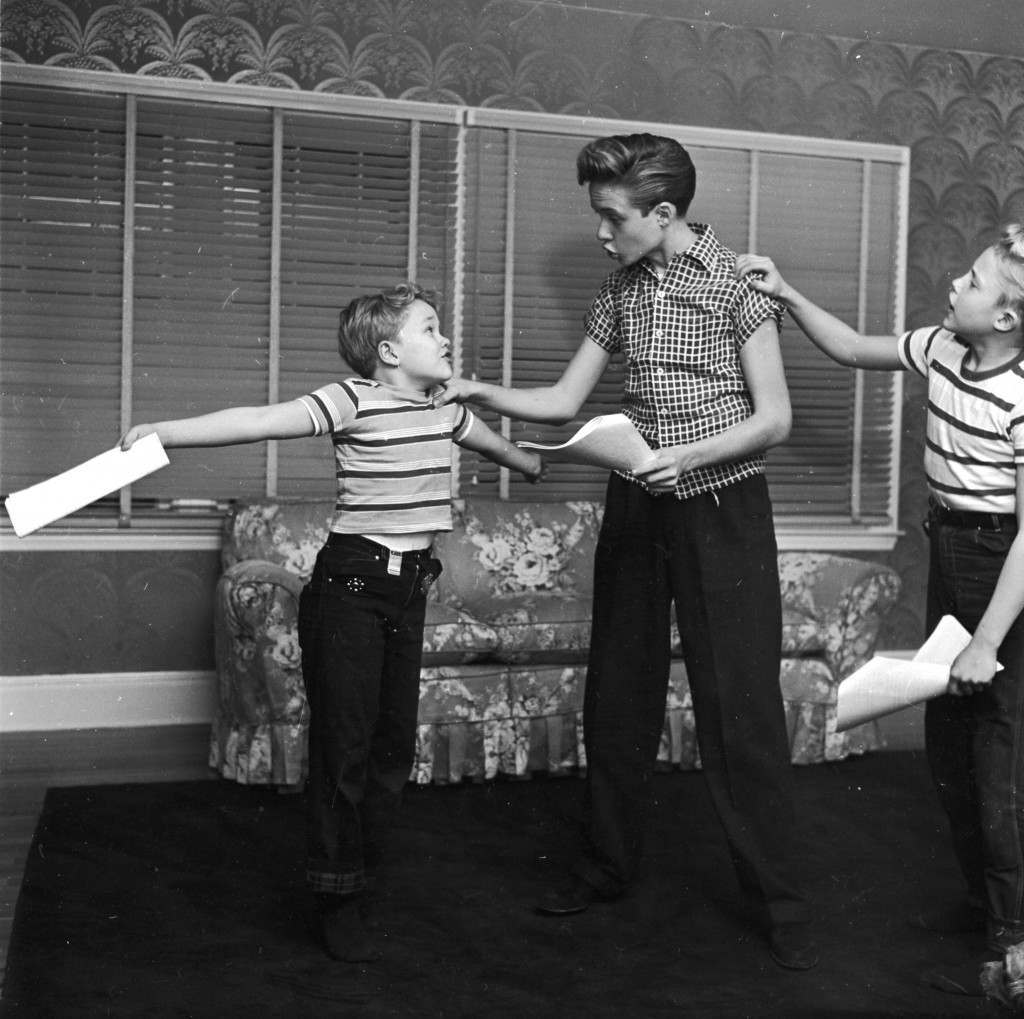 circa 1955:  Child actor Ronnie Walken (right), who later found fame as Hollywood star Christopher Walken, with his brothers and fellow child actors Glenn (right) and Ken in the living room of their home in Bayside, Long Island.  (Photo by Orlando /Three Lions/Getty Images)