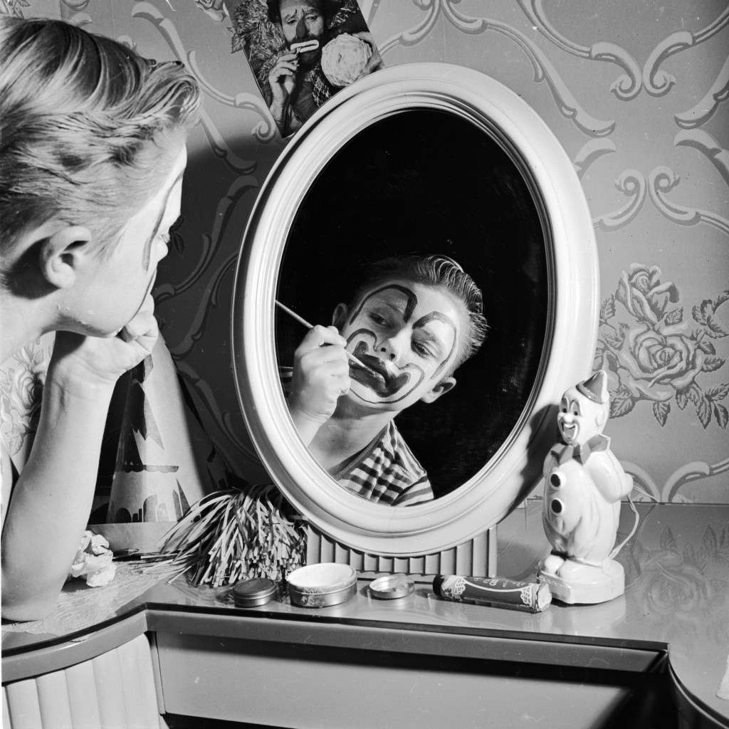circa 1955:  Child actor Ronnie Walken, who later found fame as Hollywood star Christopher Walken, painting his face with greasepaint, at his home in Bayside, Long Island.  (Photo by Al Barry/Three Lions/Getty Images)
