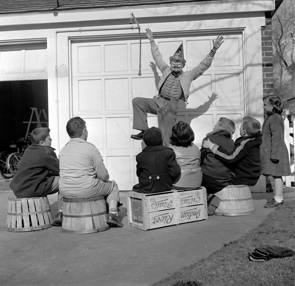 circa 1955:  Young clown Ronnie Walken, later film star Christopher Walken, performing for an audience of young neighbours.  (Photo by Al Barry/Three Lions/Getty Images)