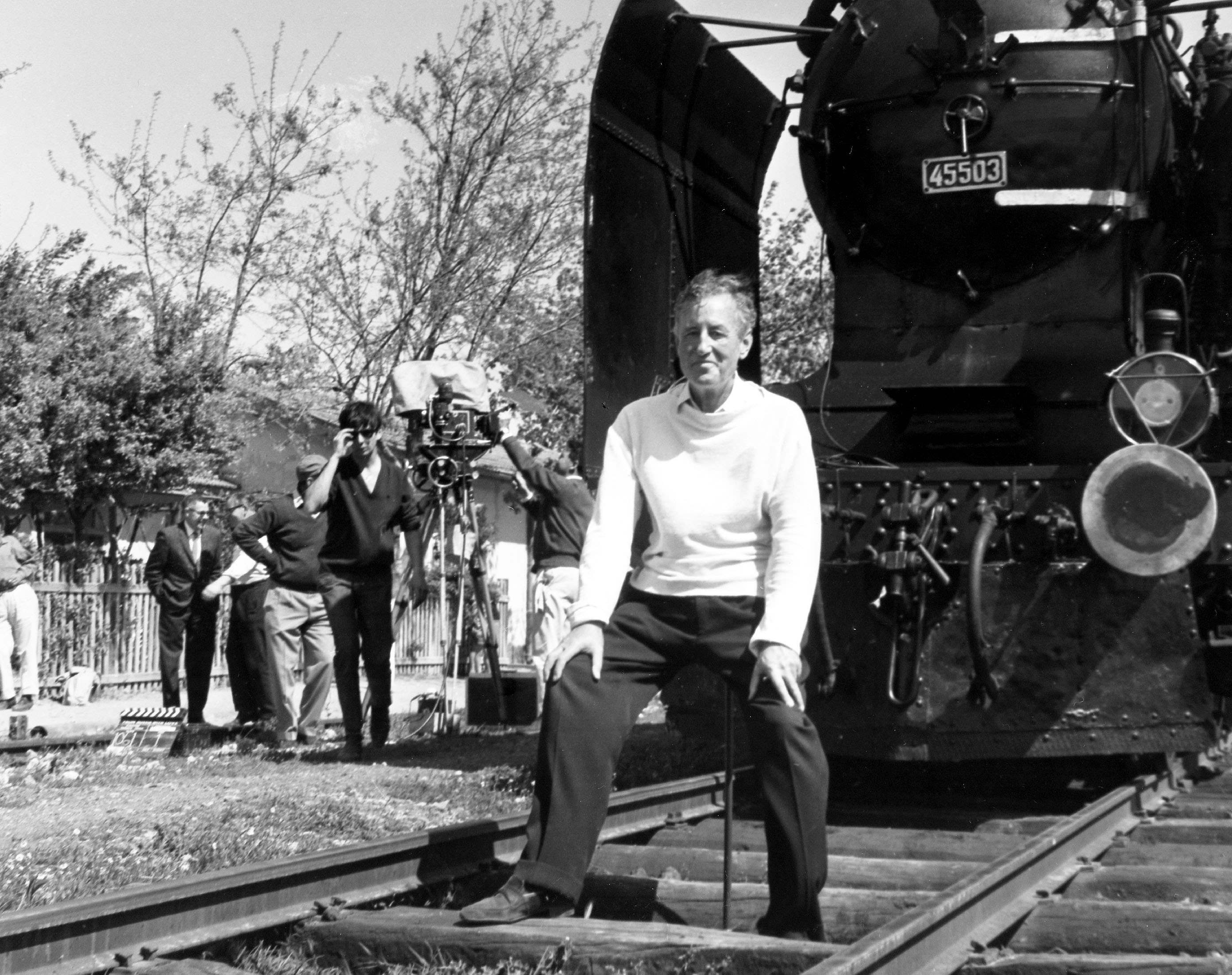 "FILE - In this June 23, 1963 file photo, British writer Ian Fleming, author of the James Bond spy thrillers, sits in front of a Turkish train, as a gag, during a visit to the set of the film ""From Russia With Love"" in Istanbul, Turkey. Fleming, a former World War II intelligence officer, created 007 as a sort of fantasy alter-ego. (AP Photo/Ahmet Baran, File)"