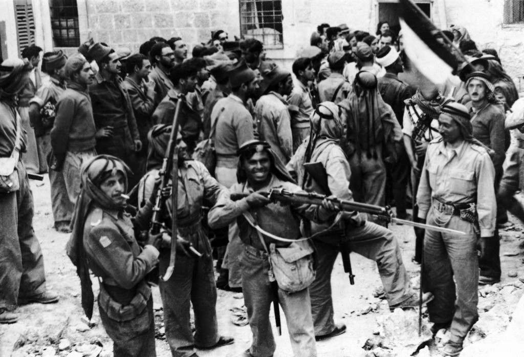 Soldiers of the Transjordan Arab Legion surround Haganah Jewish soldiers and pose with their rifles following their surrender in the old city of Jerusalem, Palestine, May 28, 1948. (AP Photo) Ref #: PA.10005836 Date: 09/06/1948