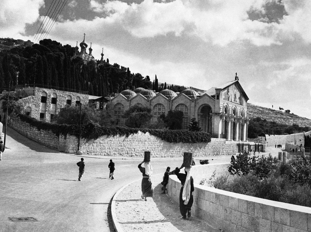 A scene on the Jericho road looking towards the multiple-domed Church of All Nations. Rising above it can be seen the Russian church of St. Mary Magdalen with its gilt cupolas, in Jerusalem, Israel, on Nov. 27, 1945. (AP Photo) Ref #: PA.10084994 Date: 27/11/1945