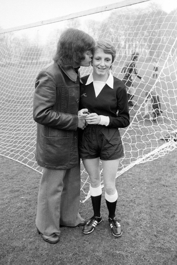 A good luck kiss for Jenny Bazely from her husband Colin, before she took charge of a men's soccer match between Croydon Old Boys and Saints Athletic. The Football Association refuse to recognise Jenny as a referee. Ref #: PA.10103142  Date: 07/02/1976