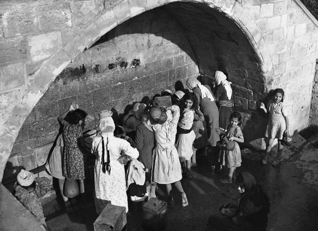 Arab women and children draw water from Mary's well in Nazareth, Israel, on Dec. 7, 1946, the ancient spring which legend relates supplies water for Mary, Joseph and Jesus. (AP Photo/J. Walter Green) Ref #: PA.10207415 Date: 07/12/1946