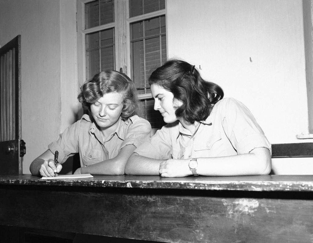 Two Jewish girls fill out their registration forms for the Jewish Army in Israel on Dec. 16, 1947. Many are now members of the semi-official Haganah. (AP Photo) Ref #: PA.10392246 Date: 16/12/1947