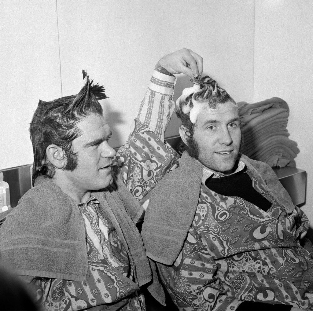 Chelsea stars David Webb (l) and Peter Osgood (r) pictured at Vidal Sassoon's Belgravia Salon. The society hairstylist, an ardent Chelsea fan, promised the players a free haircut should they reach the League Cup Final. Chelsea however would go on to lose the final 2-1 to Stoke City. Archive-PA156118-2 Ref #: PA.10482985  Date: 02/03/1972