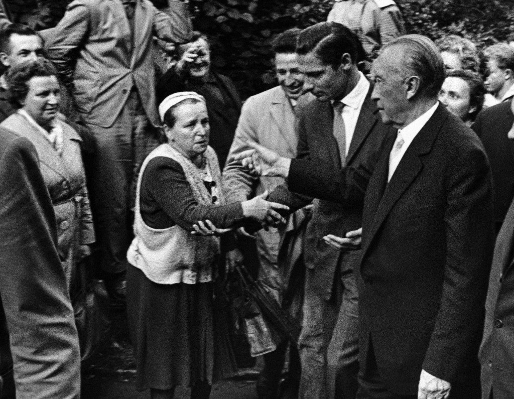 West German Chancellor Konrad Adenauer, right, greets a woman on August 22, 1961 during his visit at the Marienfelde refugee camp in Berlin, Germany, where East Germans that fled the communist regime are admitted. (AP Photo) Ref #: PA.10484742  Date: 22/08/1961
