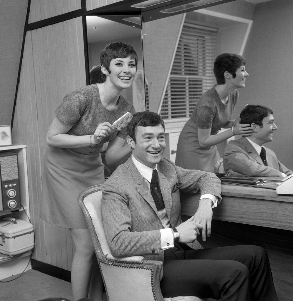 Canadian actress Beverly Adams combs the hair of her fiance, hair stylist Vidal Sassoon, at his Mayfair home. The couple plan to marry in March (1967). Archive-PA125859-1 Ref #: PA.10488495 Date: 31/12/1966