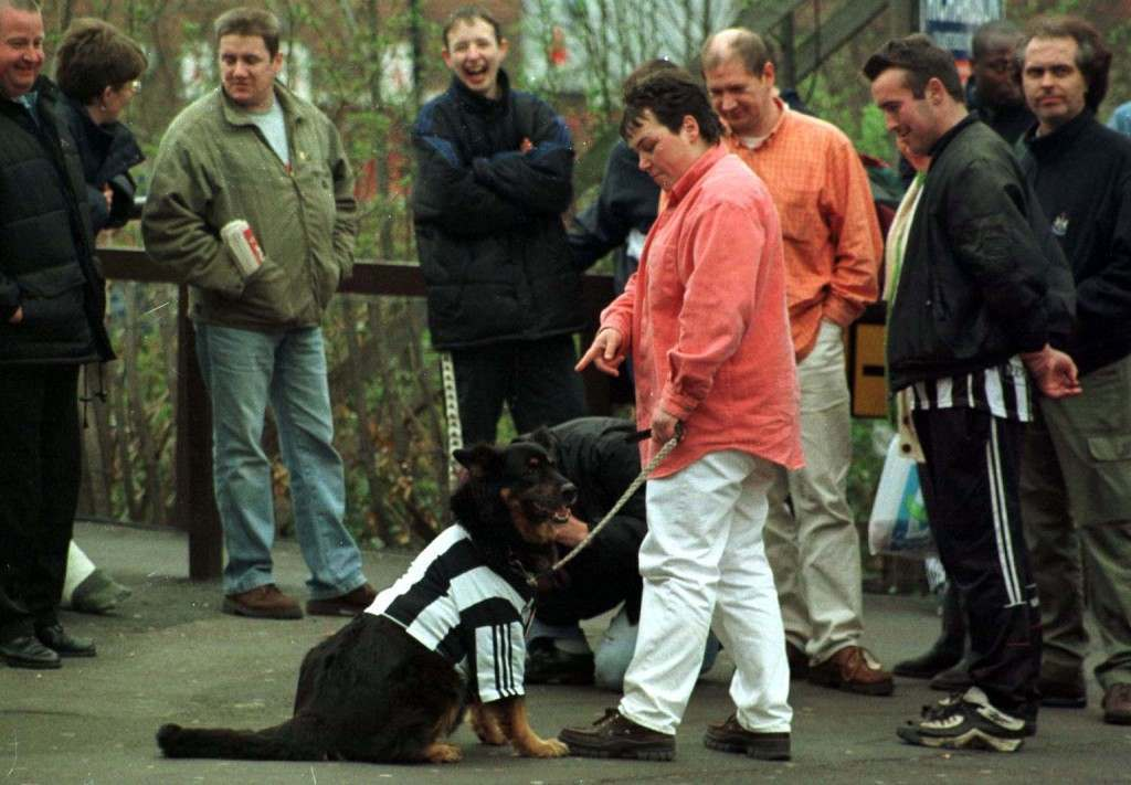 Newcastle United fans gather outside Newcastle's ground, one man brought his dog along to show what he thinks of the current directors problems, today (Monday). Photo by Owen Humphreys /PA Ref #: PA.1084530  Date: 23/03/1998