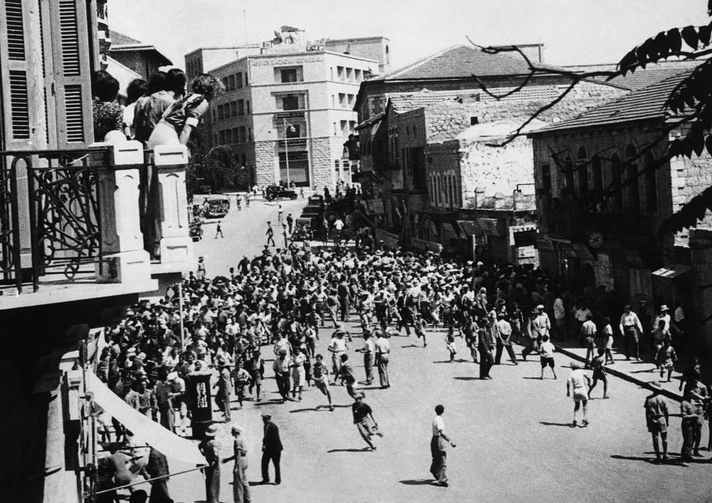 Great civil disturbances, eventually quelled by police and troops, ended a Jewish demonstration against the British proposals for the future of Palestine. One policeman was killed. Jews rushing for cover from before the baton charge of the police during the quelling of the disturbances in Jerusalem, Israel, on May 18, 1939. Note the spectators from the balcony on the left. (AP Photo) Ref #: PA.10878635 Date: 18/05/1939