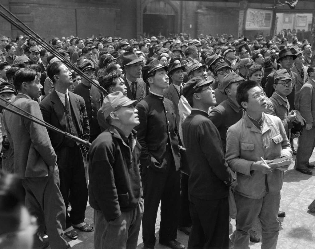 Tokyo citizens turn out to watch the bulletin boards announcing the election results for the candidates for the diet in front of the Asahi Newspaper office in Tokyo on May 7, 1947 which put up the results hourly until the final tabulation. (AP Photo) Ref #: PA.10974406