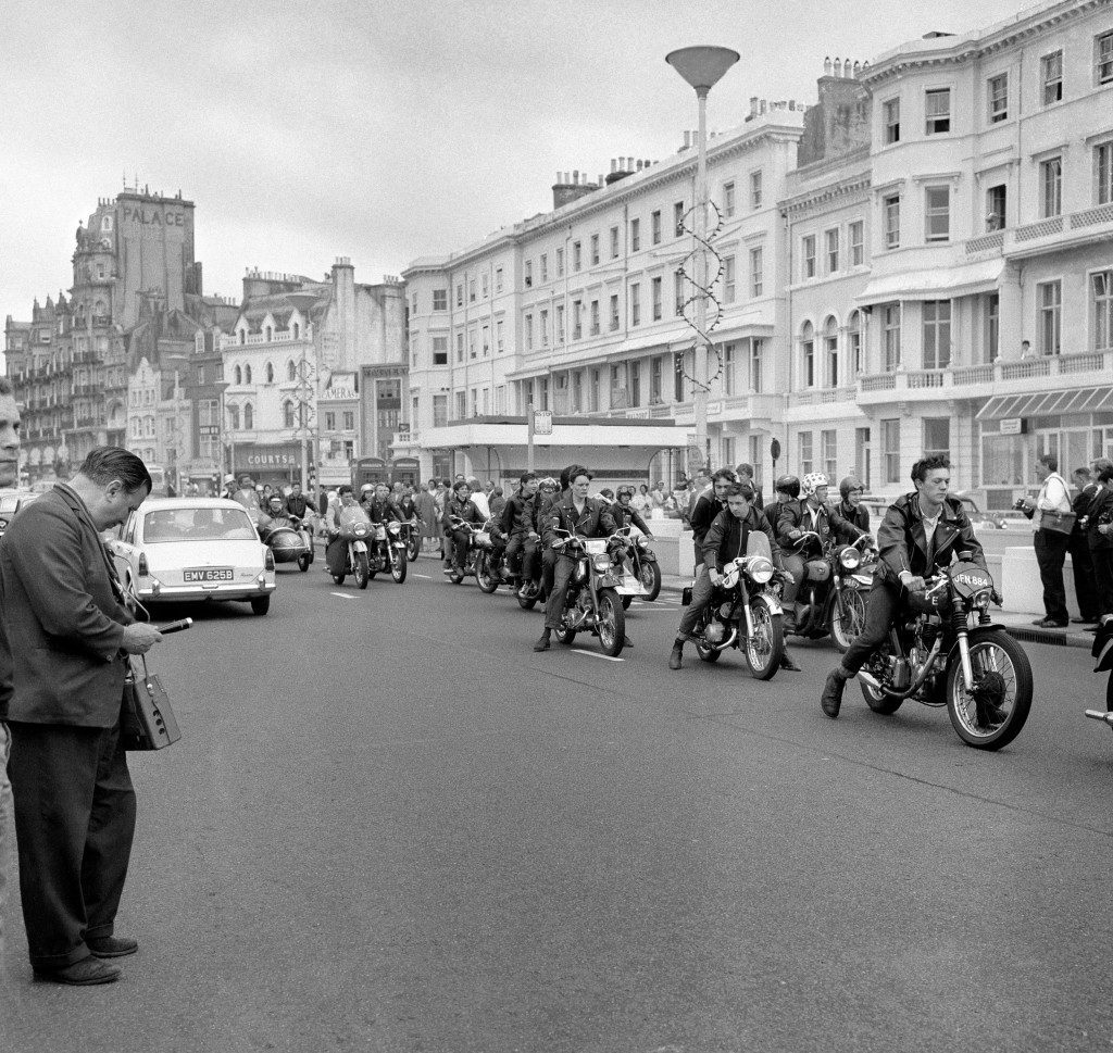 """Rockers"", traditional enemies of the scooter-riding ""Mods"", seen riding along the sea front at Hastings, just before the two groups clashed in violent scenes. Ref #: PA.1114168  Date: 02/08/1964"