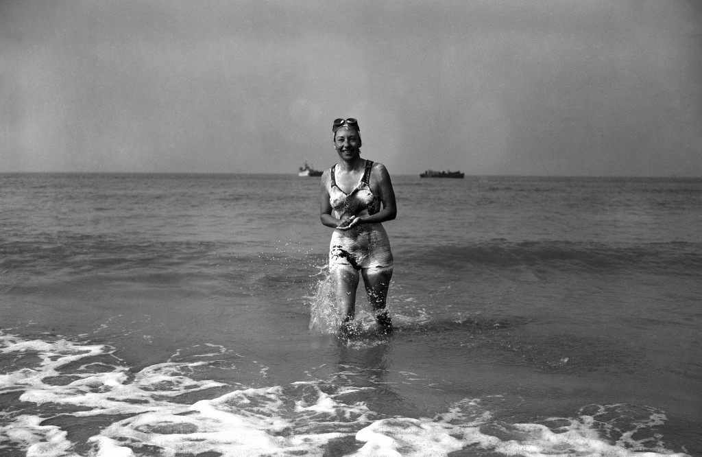 Florence Chadwick, 32, of San Diego, California, became the first woman in history to swim the English Channel both ways when she landed not far from Calais, at Sangattes after swimming from Dover on September 11, 1951. She swam from France to England in 1950. In this image Miss Chadwick lands on the French coast at Sangattes, France, still fresh and smiling, at the end of her swim on Sept. 11, 1951. (AP Photo/Jim Pringle) Ref #: PA.11141828