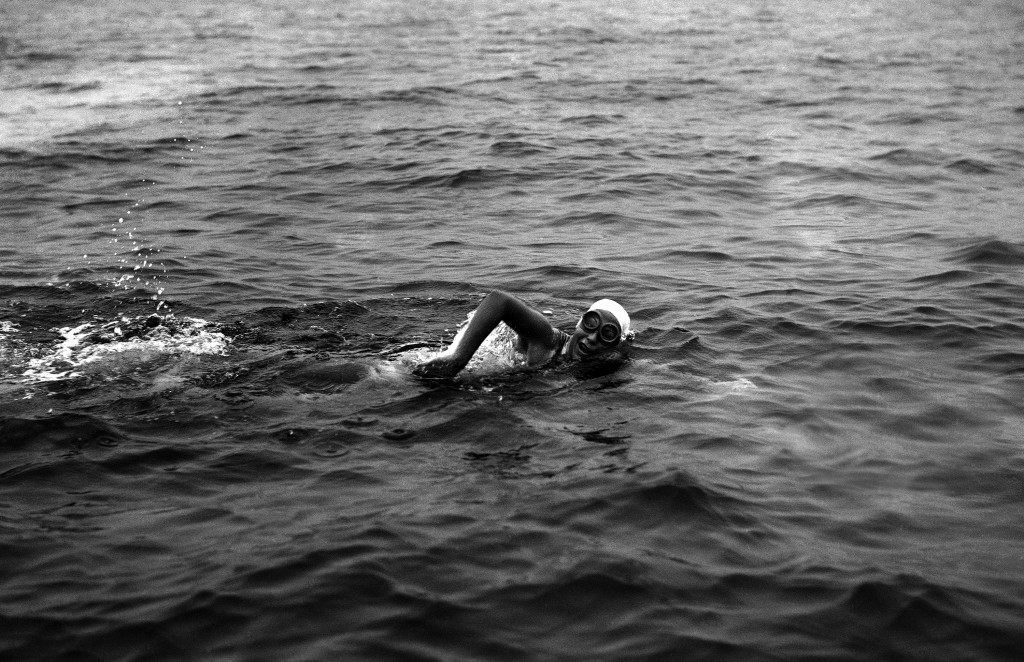Florence Chadwick, 32, of San Diego, California, became the first woman in history to swim the English Channel both ways when she landed not far from Calais, after swimming from Dover on September 11, 1951. She swam from France to England in 1950. In this image Miss Chadwick swims strongly in mid-channel on her way to France on Sept. 11, 1951. (AP Photo/Jim Pringle) Ref #: PA.11141883  Date: 11/09/1951