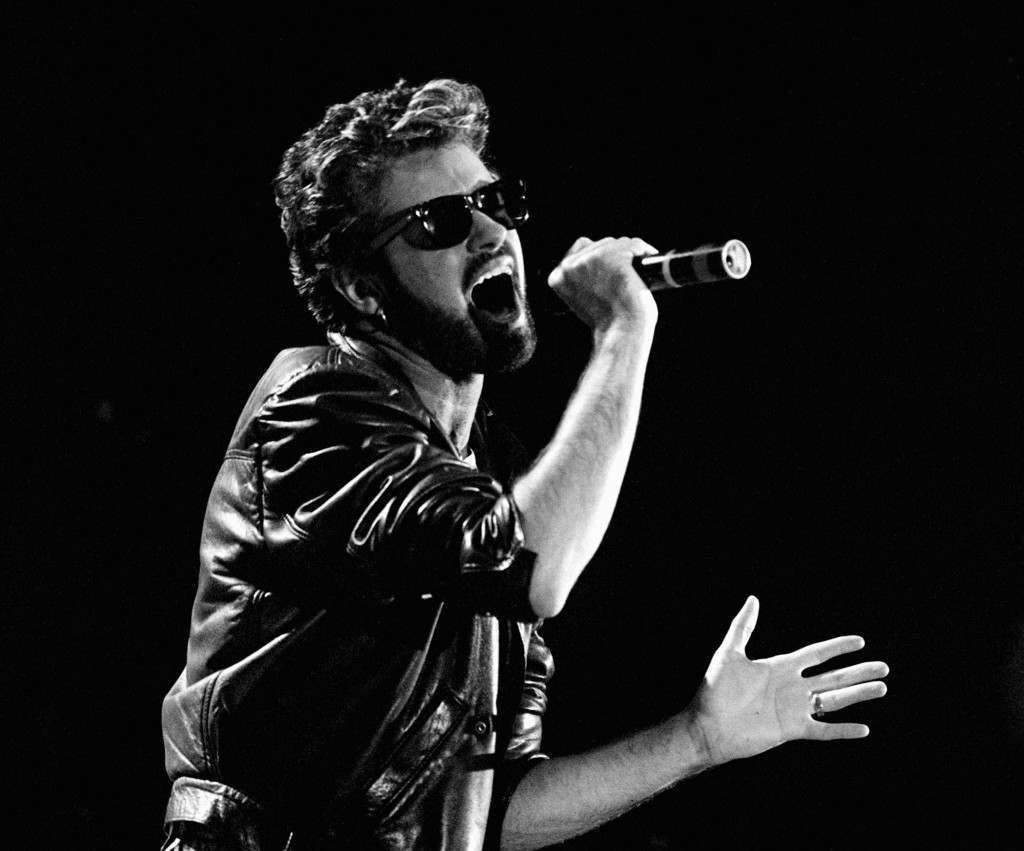 Singer George Michael on stage performing during the Live Aid Concert.  PA-1114257
