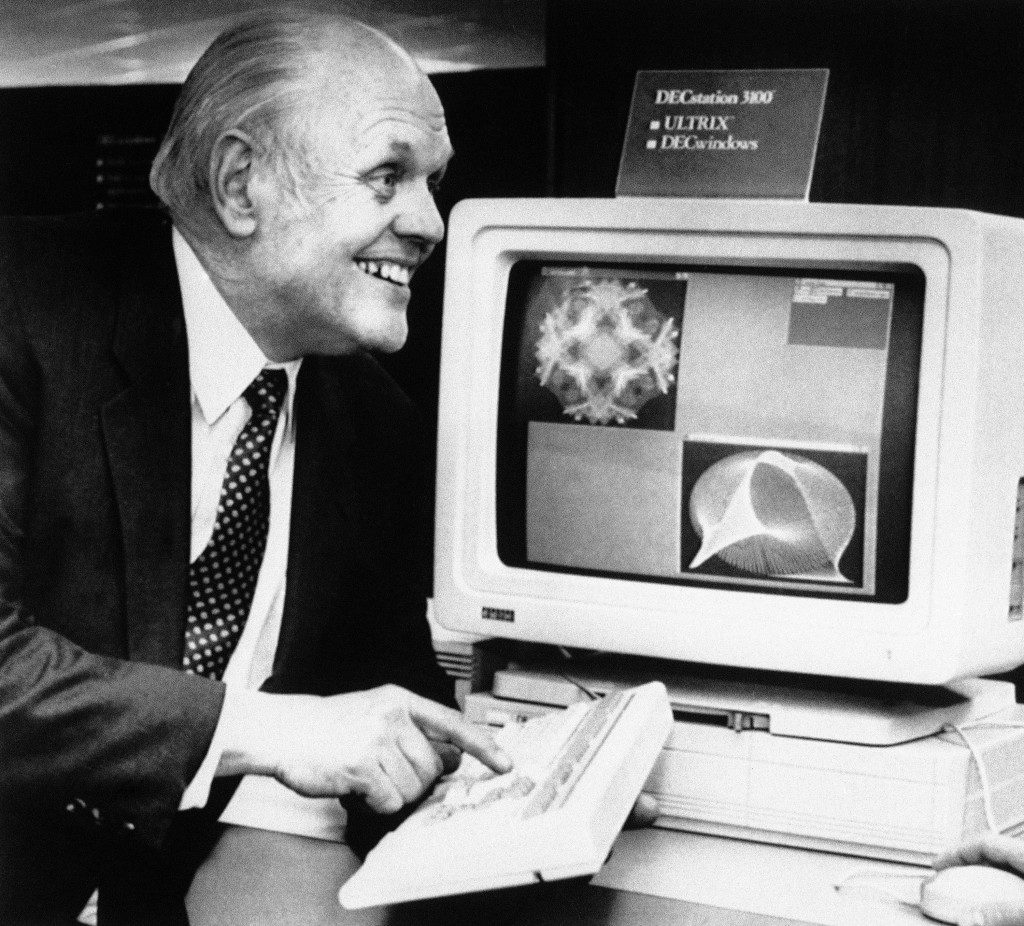 Digital Equipment Corp. president Ken Olsen reacts as he demonstrates the DEC station 3100 in Littleton, Massachusetts on Jan. 10, 1989. The DEC station 3100 is considered a breakthrough because of its speed and because it cannot run software written for Digital's VAX computer line. (AP Photo/Carol Francavilla)