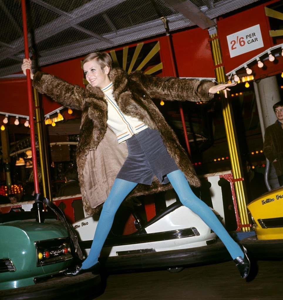 Twiggy, the model, holding onto a pole of a dodgem car at Bertram Mills Circus, Olympia. Ref #: PA.1129217  Date: 01/01/1967