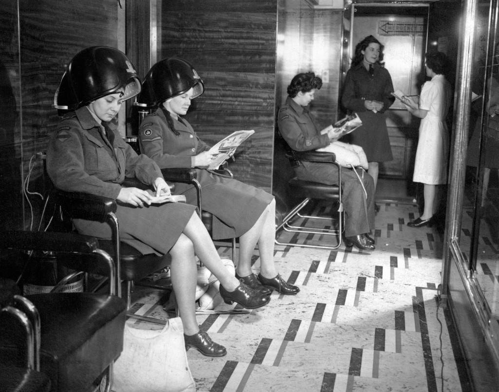 "Although the ""Queen Elizabeth"" as a transport is like a floating garrison, the beauty parlours and women's hair-dressing saloon are still in action for the servicewomen aboard. Left to right; Private Lynne Swayer, Lance-Corporal Margaret Brown, Sergt. Major Irene Collister and Private Helen Mandell. Ref #: PA.11322539 Date: 01/02/1946"
