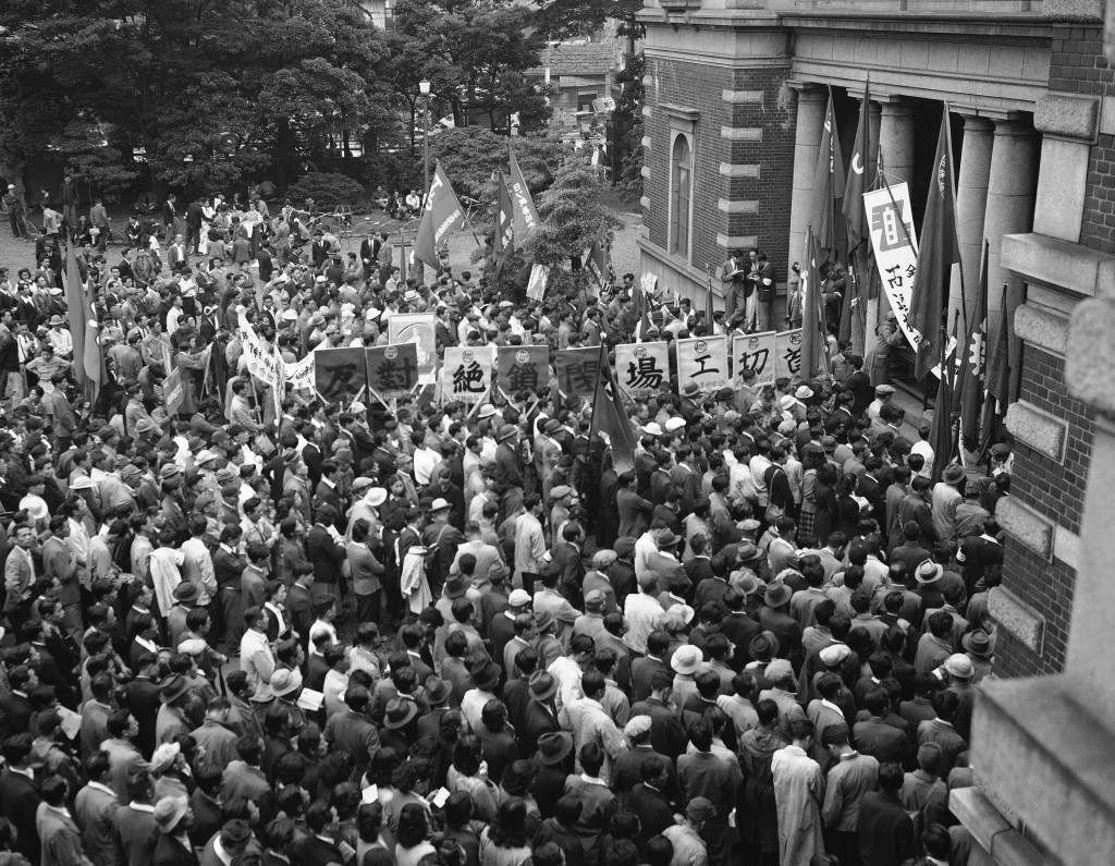 Inside the compound of the headquarters of the Japanese Red Cross in Tokyo (Shiba Park district) on June 3, 1950 as the Communists inspired workers met to demonstrate against the arrest of eight men charged with attacking a group of American soldiers in Tokyo on Memorial Day. The crowd was orderly and no reports of violence or disturbance was reported. (AP Photo/Charles Gorry) Ref #: PA.11324421
