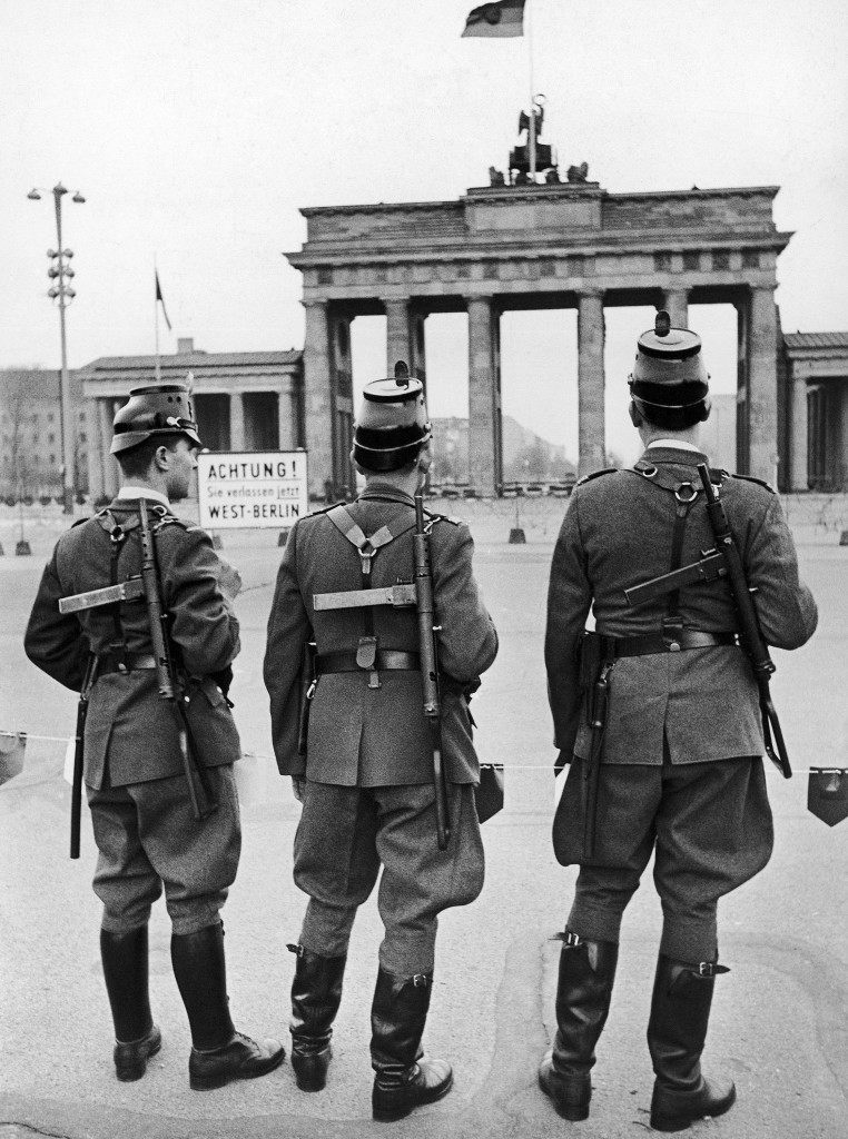 West German police wearing British machine guns which they were provided with for the first time stand in front of the Brandenburg Gate, near the sector border in Berlin, Germany on October 23, 1961. (AP Photo/Werner Kreusch) PA-11324454
