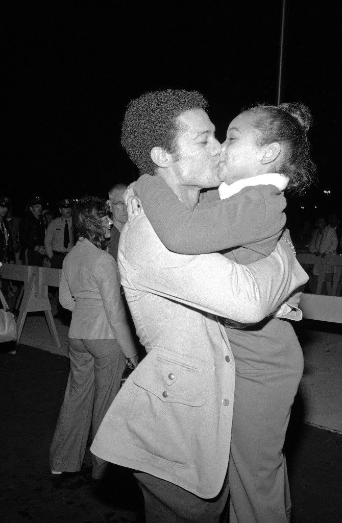 New York Yankees' Roy White gets a big hug and a kiss from his daughter Loreena, after he and his teammates defeated the Kansas City Royals in Kansas City on Sunday, Oct. 9, 1977, to clinch the American League pennant. (AP Photo/Harry Harris) Ref #: PA.11330638  Date: 09/10/1977