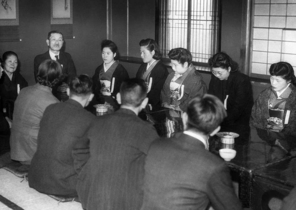 Eight girls and four men met with matrimony as the object at the Myogetsu-En, behind the Ueno Art Museum in Tokyo on Sunday, Jan. 28, 1947. The go-between the marriage interview was the Nippon (Japan) Eugenic Marriage Association which declared it has an overwhelming number of women than men on its waiting list. (AP Photo) Ref #: PA.11460510