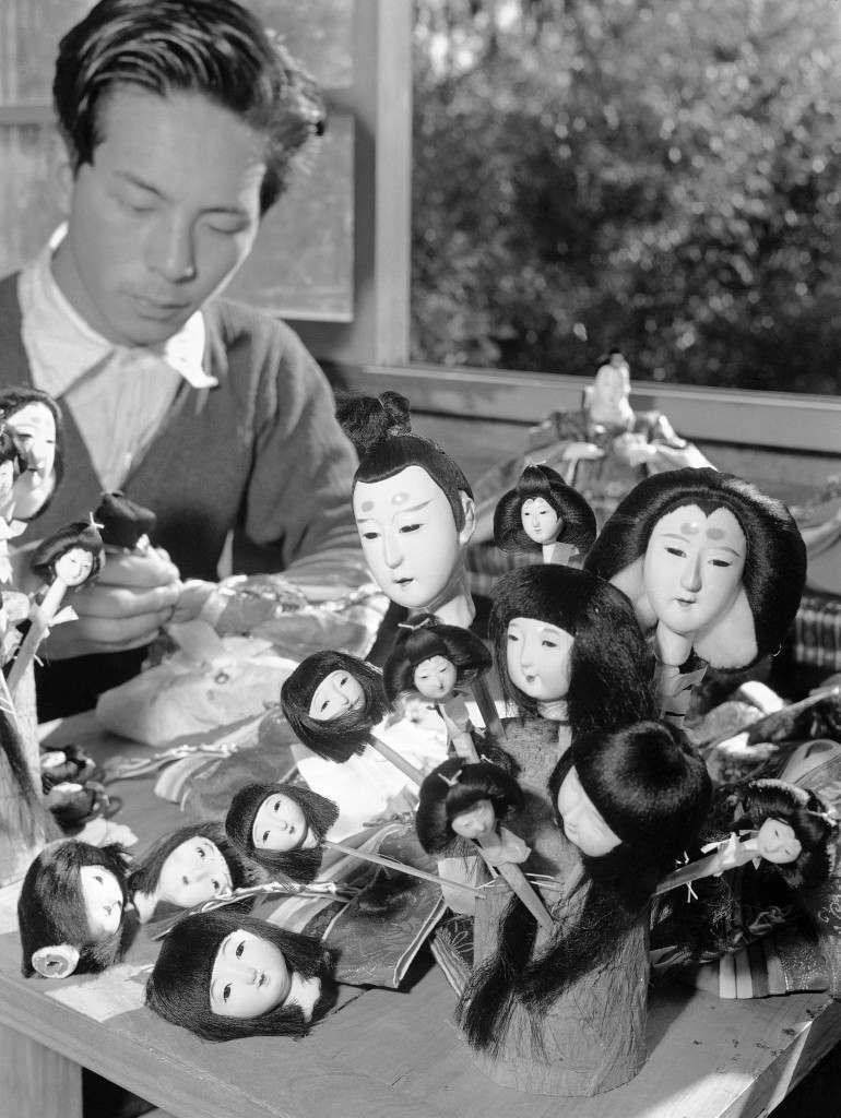 The heads all painted and the hair glued on, this Tokyo doll maker gets dolls ready for dressing in Tokyo on Jan. 26, 1950. Japan's doll makers are busy as girls day draws near. It is celebrated on April 3. (AP Photo/Charles Gorry) Ref #: PA.11466954