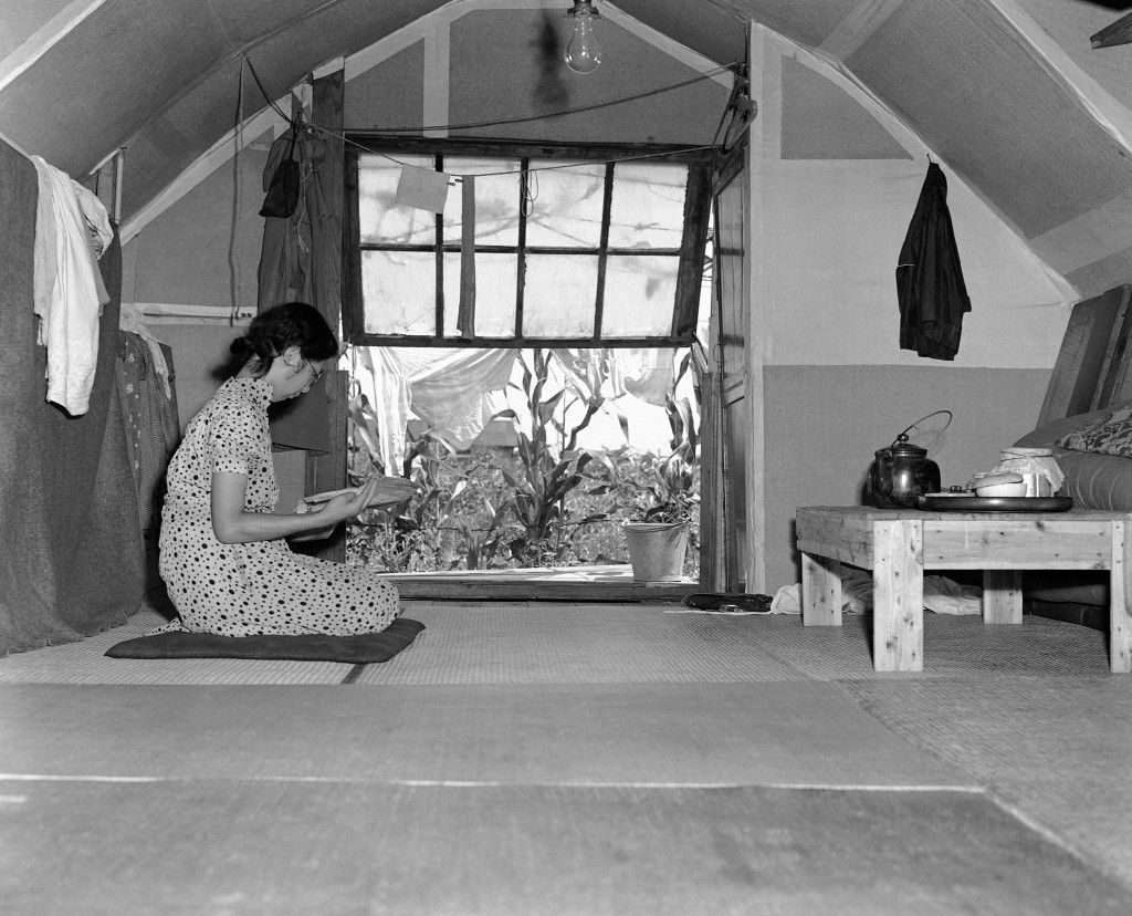 Interior of one of the homes built out of salvaged material from homes in Tokyo on July 24, 1944, that were bombed or burned. Furniture is scare but the harvest through the window looks good and a little trading with the neighbors will keep the larder stocked till the rice crop comes in. (AP Photo/Charles Gorry) Ref #: PA.11498812