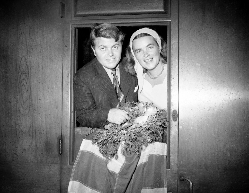 Eighteen year old Yorkshire schoolboy Philip Mickman with his wreath and flag after swimming the English Channel. He is seen aboard a train at London's King's Cross with Dutch swimmer Willy Croes Van Rijsel Ref #: PA.11535009  Date: 31/08/1949