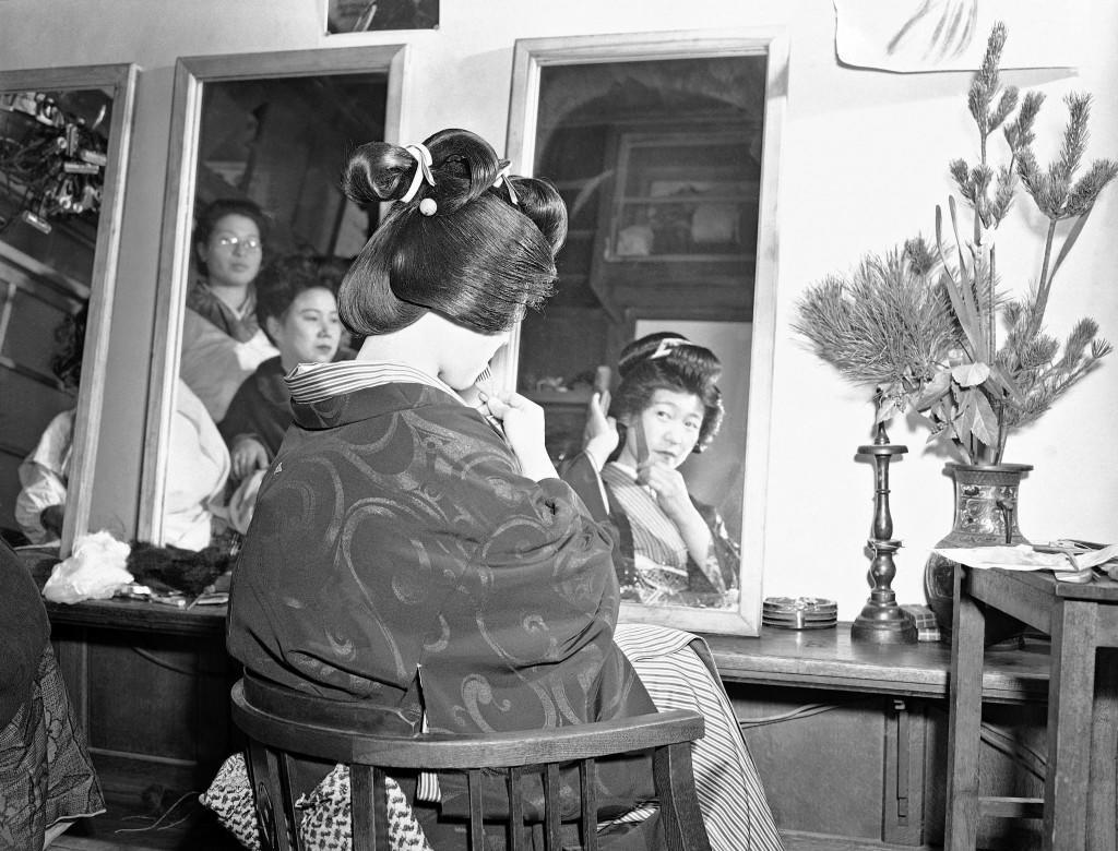 During the first weeks of the New Year, Japanese girls flock to the beauty parlors to have their hair made up in traditional Japanese style. The motive: the reconditioning is expected to serve as added attraction for male eyes throughout the year -- possibly lure a husband from among Japan's eligible's. One hopeful getting her hair done shows her coiffure almost finished at the shop on the Ginza in Tokyo, Japan on Jan. 16, 1948. (AP Photo) Ref #: PA.11538662