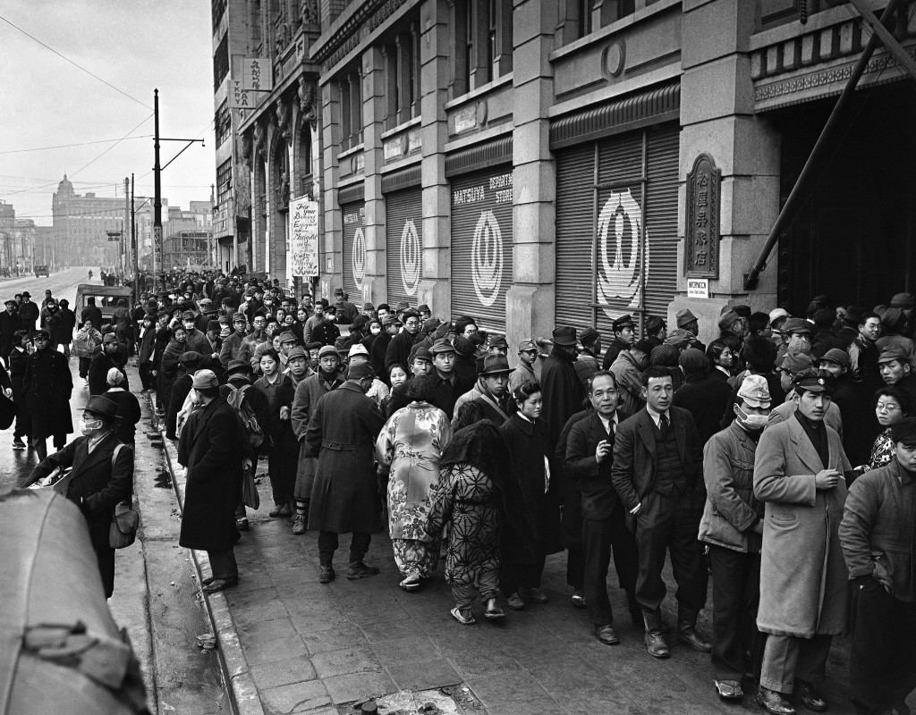 "Part of the crowd that waited in line to purchase the new Japanese cigarette ""Peace,"" ten to a packet and one pack to a customer in front of the Matsuya department store on the Ginza, Tokyo's main shopping center on Jan. 25, 1944. (AP Photo/Charles Gorry) Ref #: PA.11538769"