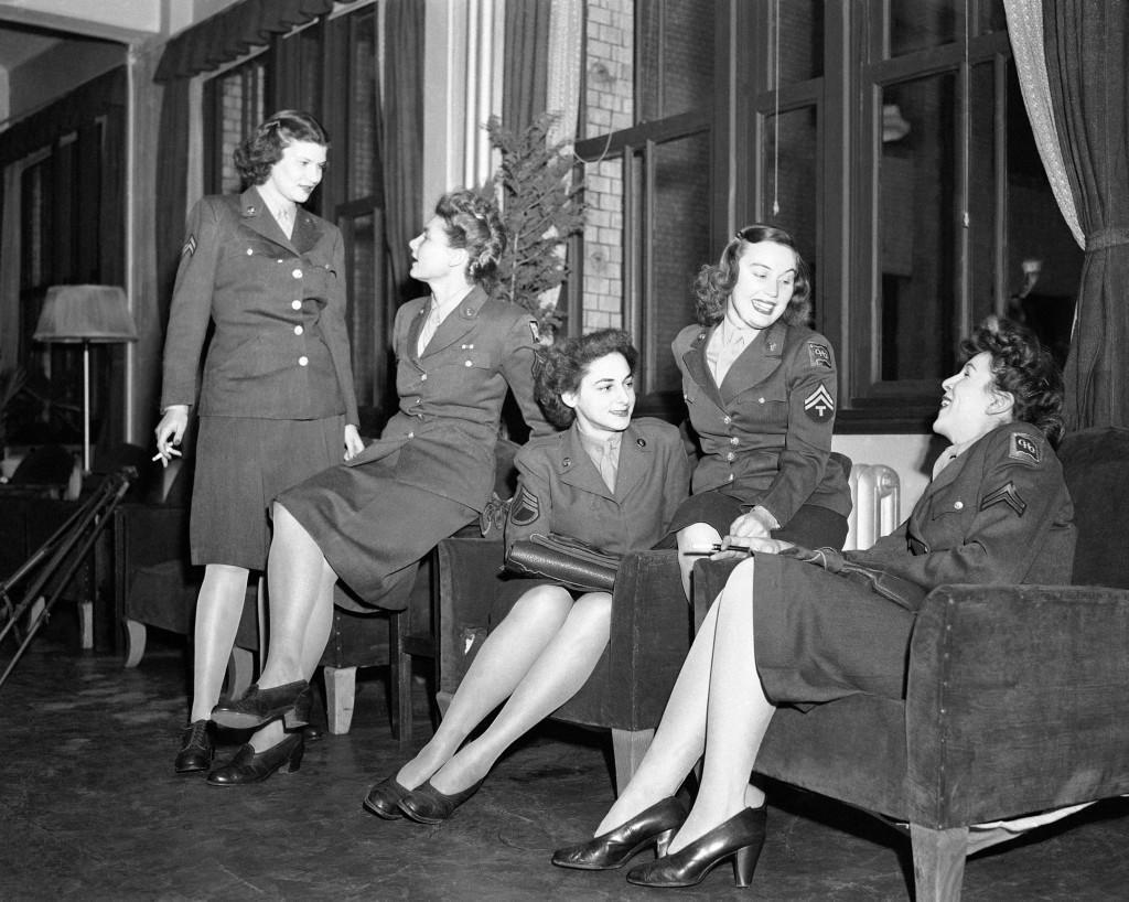 Group of WACs pose in Tokyo lounge on March 17, 1947. From left to right: Cpl. Joan Marley, Cleveland, Ohio; Cpl. Virginia Mahringer, St. Louis, Missouri; Staff Sgt. Artemus L. Bekiares, Chicago, Ill.; Cpl. Elizabeth Gordon, Norwich, Conn.; and Cpl. Virginia Schweitzer, of St. Albans, N.Y. (AP Photo) Ref #: PA.11560042