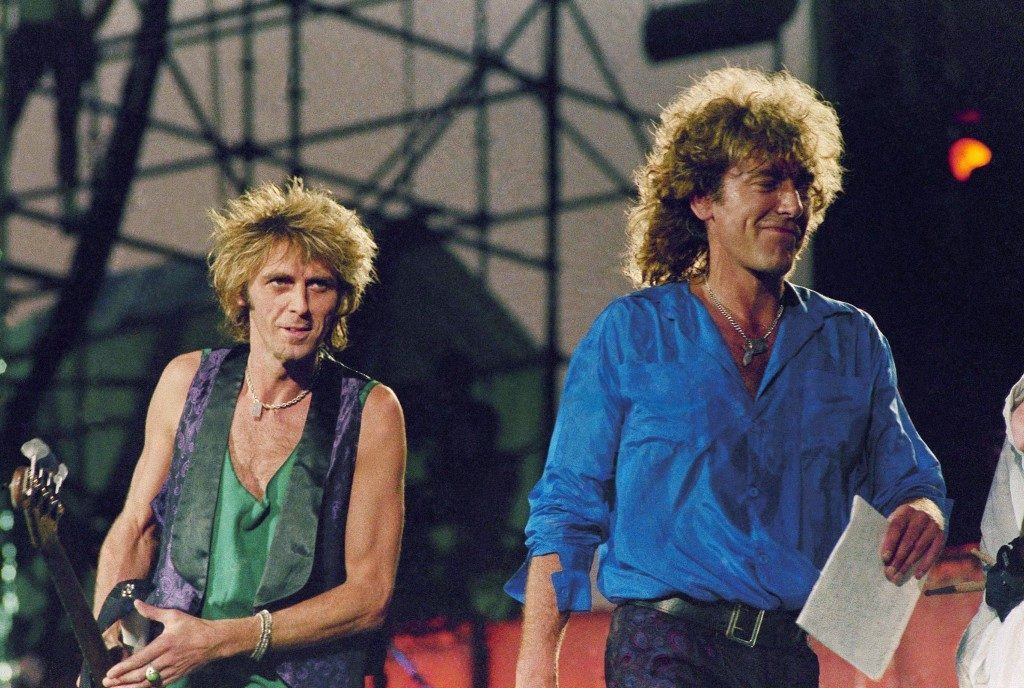 Robert Plant, right, Paul Martinez, left during Live Aid concert on July 13, 1985. Location unknown. (AP Photo/Amy Sancetta)PA-11599268