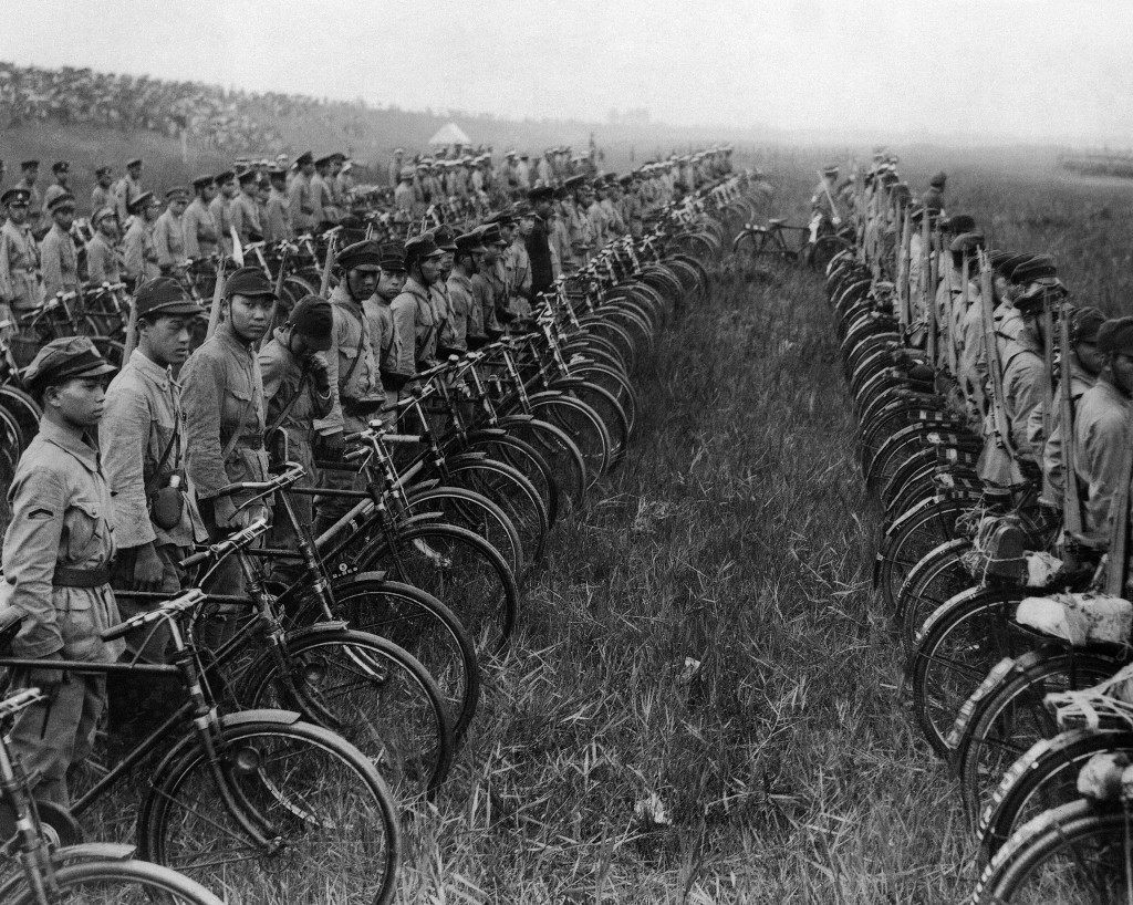 Fifty thousand students in and round Tokyo are undergoing rigorous training for war. Some of their numbers as they participate in maneuvers, equipped with bicycles to facilitate quick arrival at the front in Tokyo on Nov. 5, 1936. (AP Photo) Ref #: PA.11624754