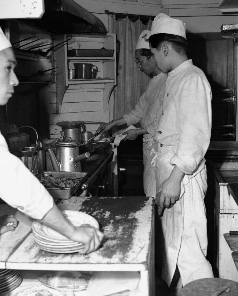"View of the kitchen on the Japan Railways Corporation express train with service to Kyoto, Osaka, and Kobe from Tokyo on April 19, 1950. Western style meals are served including ""T"" bone steaks and French fries with cocktails at a price. (AP Photo/Charles Gorry) Ref #: PA.11655875"