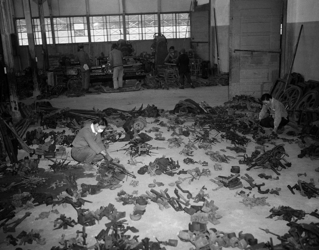 Machine tools and parts for machinery are being made with metal melted down from scrap salvaged from the wreckage of former war plants. Girl employees check salvaged material, set out on the floor of a warehouse in Tokyo on July 26, 1946, to determine what can be used and what must be melted down to make new parts. (AP Photo) Ref #: PA.11669504