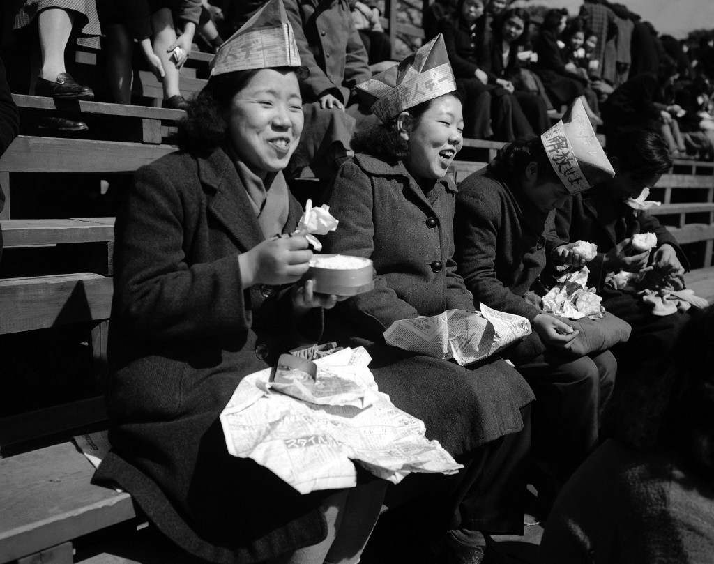 It'slunchtime for ladies attending the Communist-sponsored International Women's Day rally in Tokyo on March 16, 1949. (AP Photo) Ref #: PA.11678476