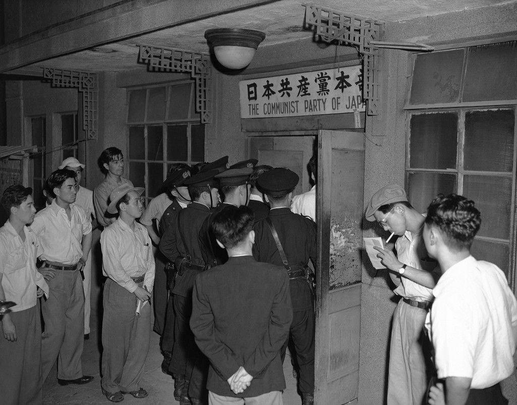 "On orders of General MacArthur, Japanese police closed Communist Party daily paper in Tokyo on June 26, 1950, for 30 days because, MacArthur said, of ""its perversion of the truth in discussing the Korean situation."" (AP Photo) Ref #: PA.11678485"