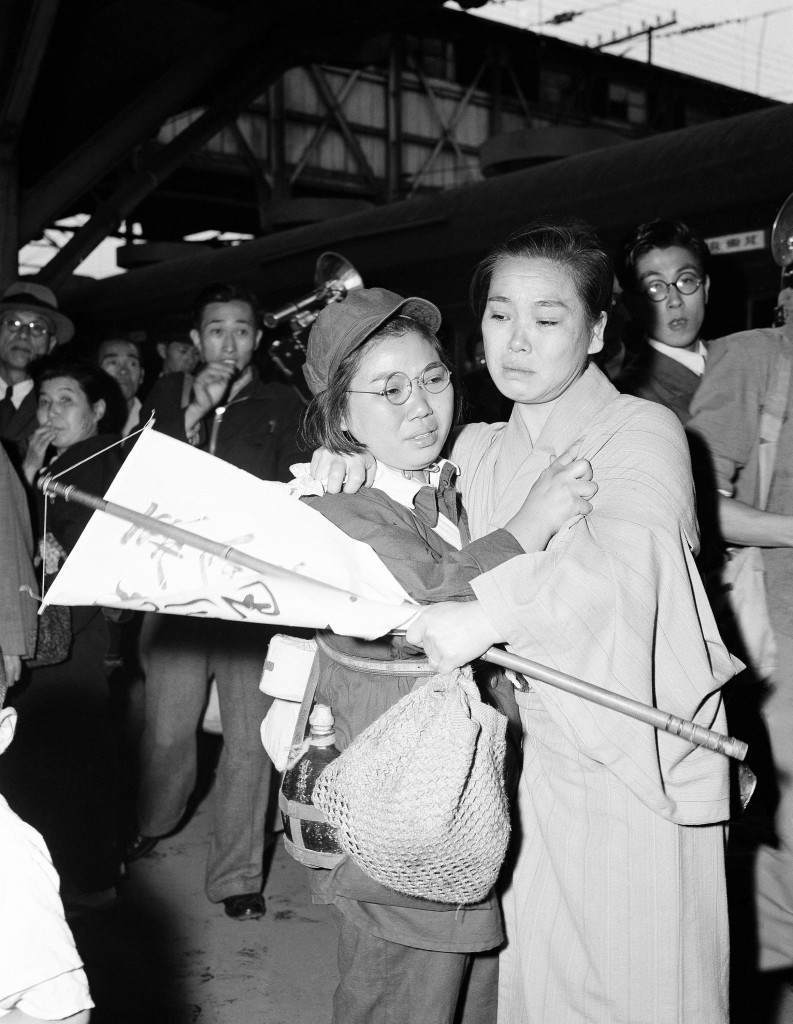 A mother and daughter meet after ten years of separation at Tokyo station on Oct. 7, 1949. They were separated on the continent during the war against China. The youngster, whose father died in the interim, wears a Communist type uniform given to her in Manchuria. (AP Photo) Ref #: PA.11679155