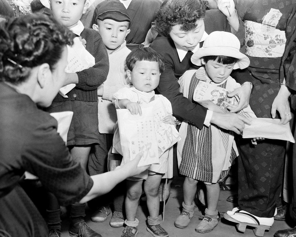 The first shipment of repatriates to arrive in Tokyo on Oct. 1, 1949, from Russian held territory of Dairen, Manchuria, which numbered among its group young children whose parents died overseas. They were met by social workers at Tokyo central station and will be taken to rest camps until relatives of the parents can be located. (AP Photo) Ref #: PA.11679157