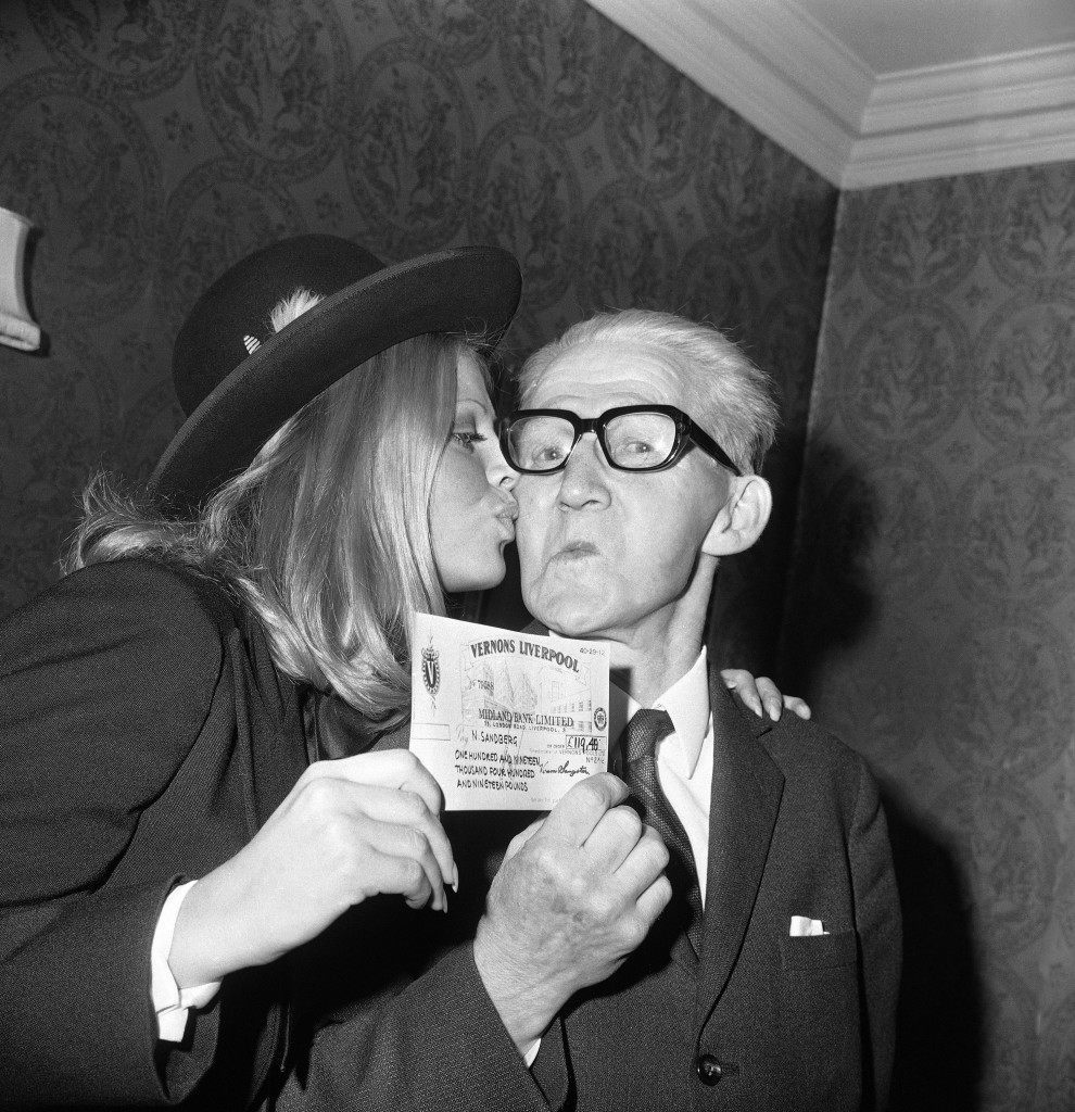 A kiss from Swedish actress Britt Ekland for Mr. Nile Sandberg, of Sweden, after she had presented him with a check for £119,000, at a reception in London, United Kingdom on Oct. 21, 1971, following Mr. Sandberg's win on Vernons Treble Chance Pool. Finding Mr. Sandberg, to give him the good news, proved to be quite a job. The Vernon's representative had to travel to a coastal village in Southern Sweden, in his search for the 75-year-old widower....only to find he was away on holiday. Mr. Sandberg was finally tracked down to Copenhagen, whore he was visiting a niece. (AP Photo/Leonard Brown) Ref #: PA.11721246  Date: 21/10/1971