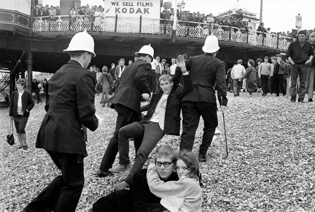 White helmeted Brighton police arresting youths during fighting between Mods and Rockers and the police on Brighton beach. Ref #: PA.1175546  Date: 18/05/1964