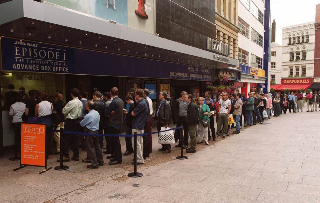 Star Wars fans have queue outside the Odeon Leicester Square cinema in London as they clamour to be the first in the UK to see the latest part of the saga. More than 100,000 seats were booked after tickets went on sale just after midnight, with many buying in person. Ref #: PA.1204258 Date: 01/07/1999