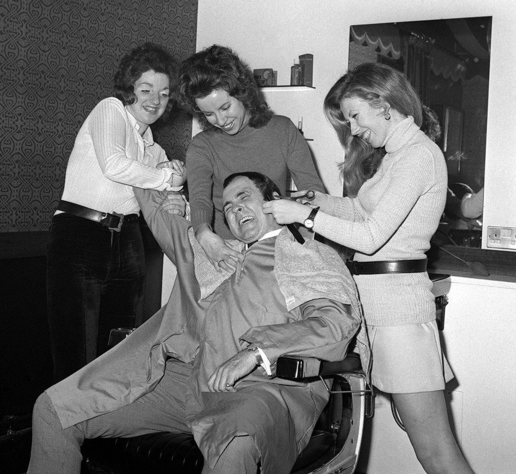 Wrestler Mick Mcmanus receiving a haircut from Sally Greville-Smith, Angela Gleeson and manageress Sue Piper at Fagin's hairdressing salon in Carnaby Street, London. Ref #: PA.1204360  Date: 24/04/1970
