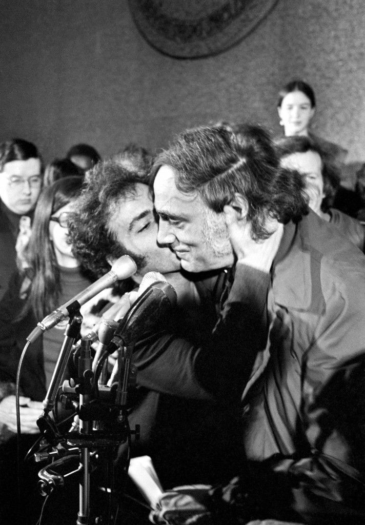 Jerry Rubin, left, plants kiss on cheek of attorney William M. Kunstler in Chicago on Thursday, Dec. 6, 1973, after both had been freed from any jail sentences on contempt of court convictions in connection with their Chicago 7 conspiracy trial. David Dellinger and Abbie Hoffman were also freed of serving sentence for their contempt convictions, but were not present in court. All of the defendants in the case had been cleared of the charges for which they were brought to trial in 1968. (AP Photo/Charles Knoblock) Ref #: PA.12408283  Date: 06/12/1973