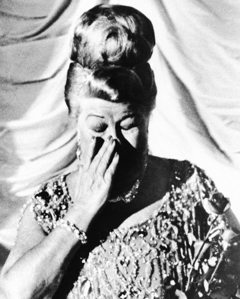 Sophie Tucker, celebrating her 60th year in show business, wipes a tear from her eye at the end of performance at the Latin Quarter night club in New York City, Sept. 23, 1964. Miss Tucker says she has no thoughts of retiring. (AP Photo/Matty Zimmerman) Ref #: PA.12521910