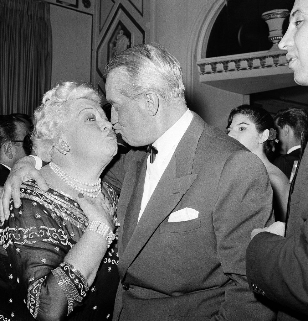 "Two veterans of the show business world, Sophie Tucker and Maurice Chevalier, met in Hollywood, March 5, 1959 at the annual Golden Globe awards dinner of the Hollywood Foreign Press Association. They brought down the house with a duet a few minutes later. Chevalier had come from Paris to accept an award for ""Outstanding Contributions to the Entertainment World."" (AP Photo/Harold P. Matosian) Ref #: PA.12578146"