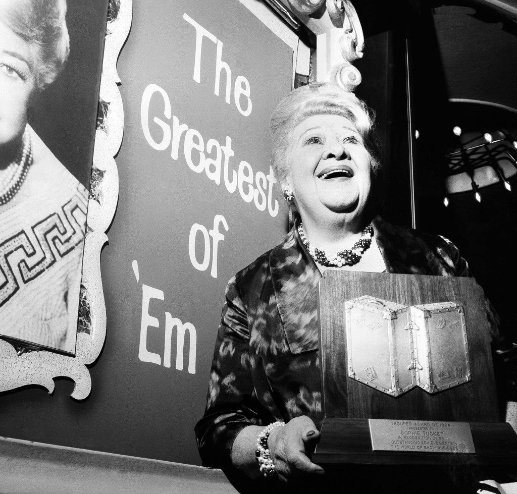 "Singer Sophie Tucker, 75, billed as, ""The Last of the Red Hot Mamas,"" holds a trophy honoring her 60th anniversary in show business, May 4, 1964. Sophie, who is still active in the entertainment field, was honored on May 3 in New York City by The Troupers, an organization of the wives of show business personalities. (AP Photo) Ref #: PA.12578149"