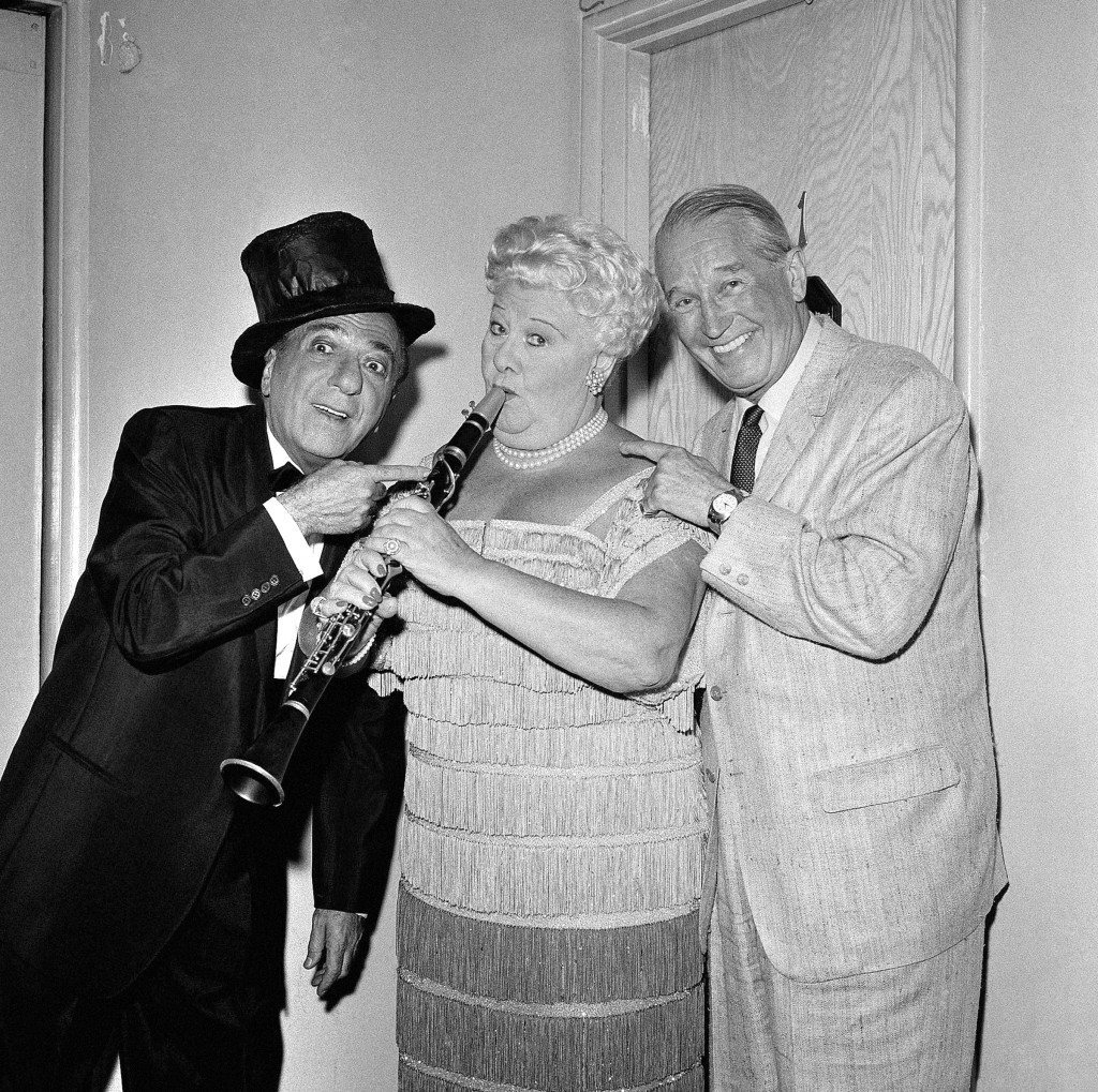 Ted Lewis and Sophie Tucker, who are appearing as co-headliners at the Moulin Rouge in Hollywood are visited by entertainer Maurice Chevalier, right, backstage, Aug. 13, 1959. (AP Photo) Ref #: PA.12578151
